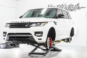 White Ranger Rover Detailed BendPak Mid Rise Lift
