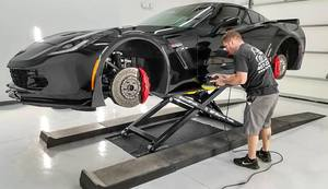 Detailing Black Corvette BendPak Mid Rise Lift